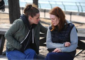 As her mother's primary caregiver, Lydia (Kristen Stewart) tries to comfort a sad and spacey Alice (Julianne Moore). Image courtesy of Sony Pictures Classics.