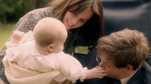 Felicity Jones as Jane Wilde Hawking with husband (Eddie Redmayne) and baby. Image courtesy of Focus Features.