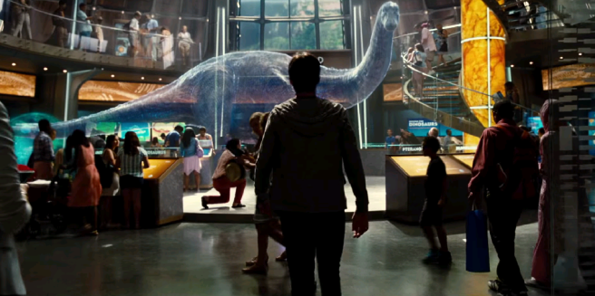 Jurassic Park's skeletal recreation welcomed visitors to explore the past; Jurassic World patrons can glimpse the future. Image courtesy of Universal Pictures.