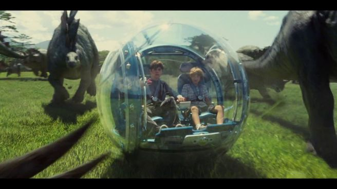 Zach and Gray, just a couple of kids. And some dinosaurs! Image courtesy of Universal Pictures.