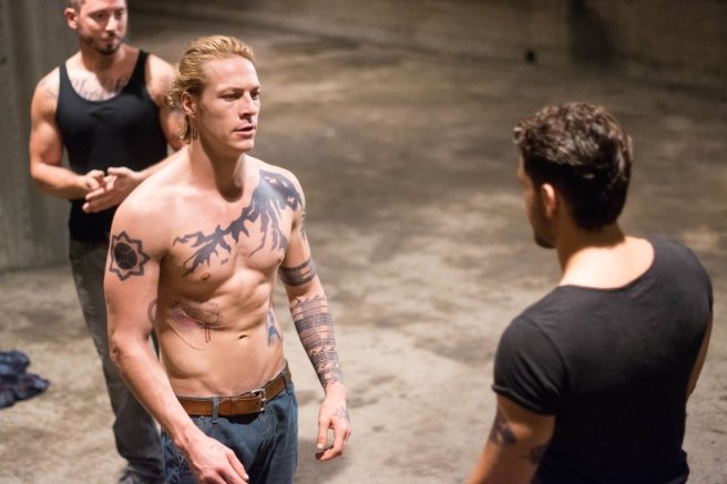 C'mon, Bodhi, why don't you take off your shirt, too? You know you wanna... Image courtesy of Warner Bros.